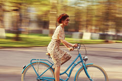 Cheerful girl on a bicycle Stock Photo