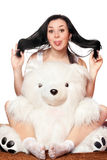 Cheerful girl with a teddy bear Stock Photography