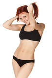 Cheerful girl in black sports lingerie. Royalty Free Stock Images