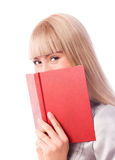 Cheerful girl with a book Royalty Free Stock Photography