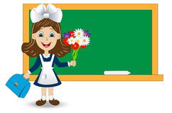 Cheerful girl with a bouquet of flowers on the school Board Stock Photo