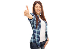Cheerful girl with braces giving a thumb up Stock Image
