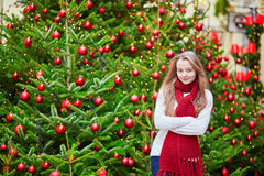 Cheerful girl with brightly decorated Christmas tree Stock Photos