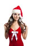 Cheerful girl in a cap of Santa Claus. Stock Photos
