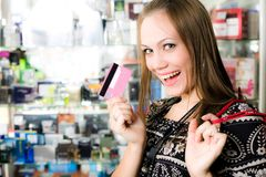 Cheerful girl with card. Cheerful long-haired girl with card Stock Photos