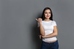Cheerful girl in casual clothes posing at studio Stock Photography