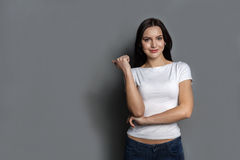 Cheerful girl in casual clothes posing at studio Royalty Free Stock Images