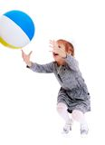 Cheerful girl catches the ball Stock Photos