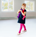 Cheerful girl cheerfully walks through the room. Stock Photo