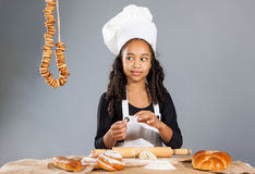 Cheerful girl chef Stock Image