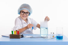 Cheerful girl chemist puts experience Royalty Free Stock Image
