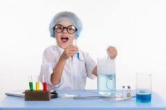 Cheerful girl chemist Stock Photo