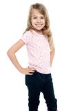 Cheerful girl child with hands on waist Stock Photos