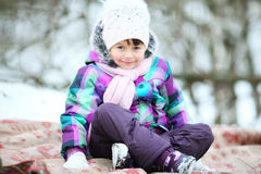 Cheerful girl child in the park in winter Royalty Free Stock Image
