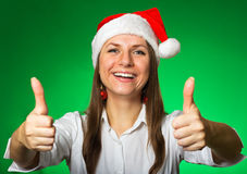 Cheerful girl in a Christmas hat Stock Photos