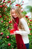 Cheerful girl with Christmas present Stock Images