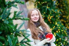Cheerful girl with Christmas present Stock Photography