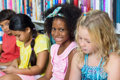 Cheerful girl with classmates Royalty Free Stock Images