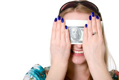 Cheerful girl closes her eyes a pack of dollars Royalty Free Stock Photos
