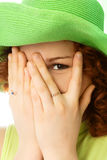 Cheerful Girl Closing Her Face With Hands Royalty Free Stock Photography