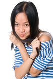 Cheerful girl with compressed lips Stock Photos