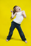 Cheerful girl dances. Stock Photos