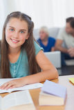 Cheerful girl doing her homework Royalty Free Stock Photography