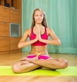 Cheerful girl doing yoga at home Royalty Free Stock Image