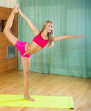 Cheerful girl doing yoga at home Royalty Free Stock Photos
