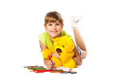 Cheerful girl draws pencil Stock Image