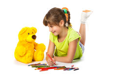 Cheerful girl draws pencil Stock Photo