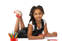 Cheerful girl draws pencil lying on the floor Stock Image