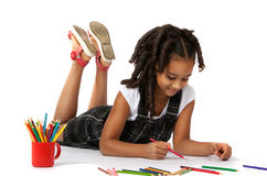 Cheerful girl draws pencil lying on the floor. Isolation on white background Royalty Free Stock Image