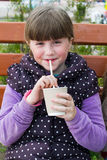 Cheerful  girl with a drink Royalty Free Stock Photography