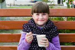 Cheerful  girl with a drink Stock Photography