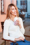Cheerful girl drinking a cocktail in the hot summer day. Stock Photo