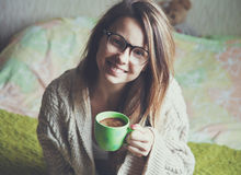 Cheerful girl drinking coffee Royalty Free Stock Photos