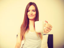 Cheerful girl drinking coffee. Royalty Free Stock Images
