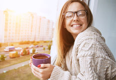 Cheerful girl drinking coffee in morning Stock Image