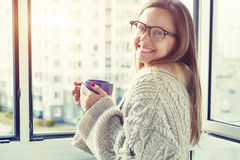 Cheerful girl drinking coffee or tea Stock Photography