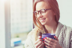 Cheerful girl drinking coffee Stock Images