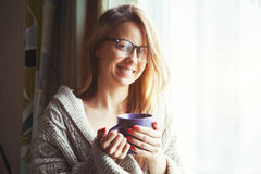 Cheerful girl drinking coffee Royalty Free Stock Photos