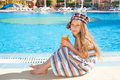 Cheerful girl drinking juice Stock Photos