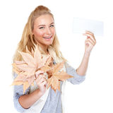 Cheerful girl with dry maple leaves Royalty Free Stock Image