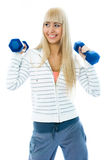 Cheerful girl with dumbbells Stock Images
