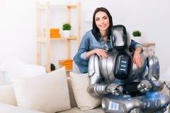 Cheerful girl embracing robot Royalty Free Stock Image