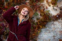 Cheerful girl enjoying autumn nature Royalty Free Stock Photography