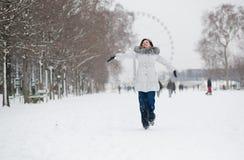 Cheerful girl enjoying beautiful winter day in Paris Stock Images