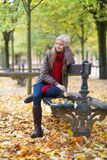 Cheerful girl enjoying bright fall day royalty free stock image