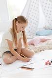 Cheerful girl enjoying drawing Stock Photos